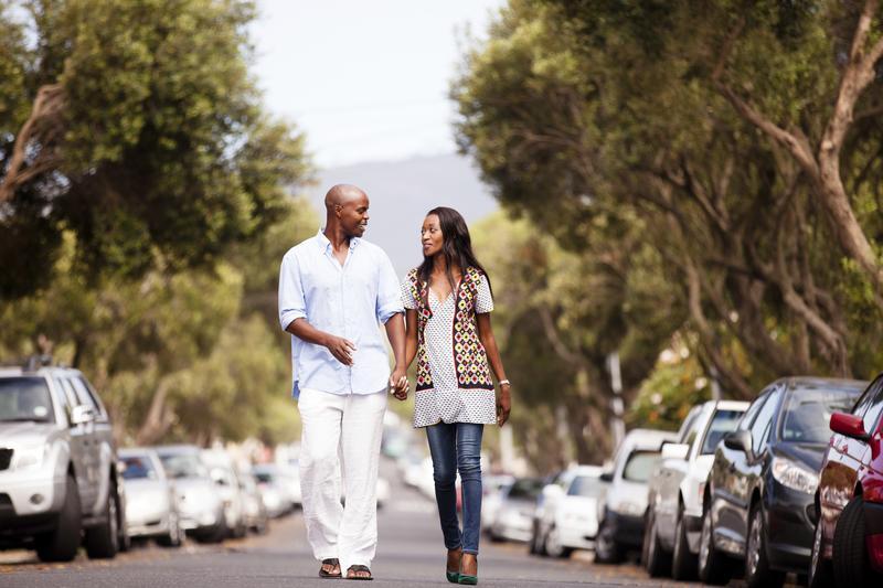 couple_walking_down_neighborhood_street.jpeg