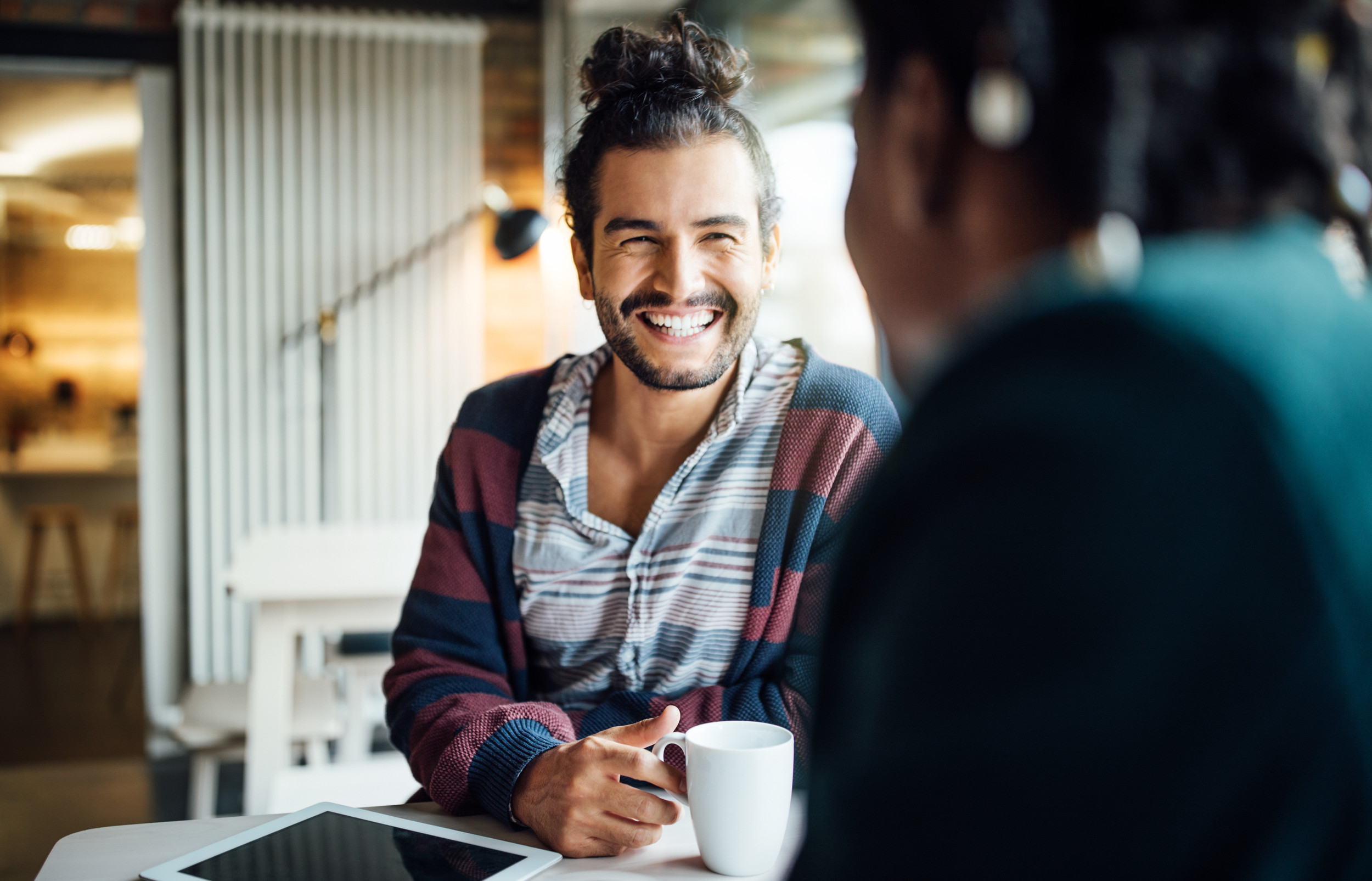 Happy businessman having coffee with colleague