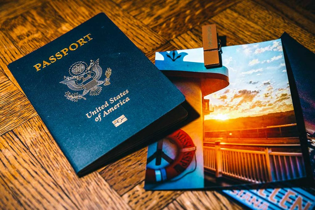 a passport and a cruise photo of a sunset
